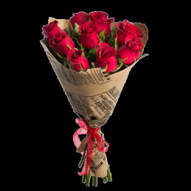 Букет из 9 красных роз в крафт-бумаге